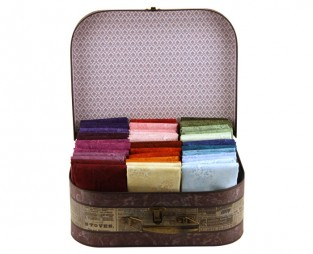 A rainbow of colours - 50 fat quarters tucked into a Charlestone case by Sew Easy