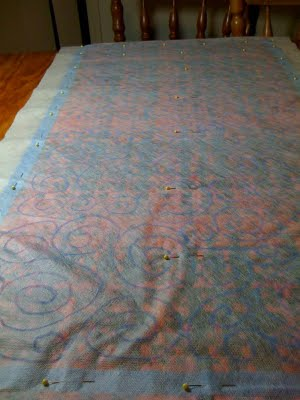 Woven piece with stabiliser on front and back